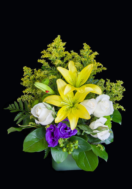 Delight someone with this fresh eye-catching arrangement of yellow lilies, purple lisianthus and roses, accented with yellow solidago and greens