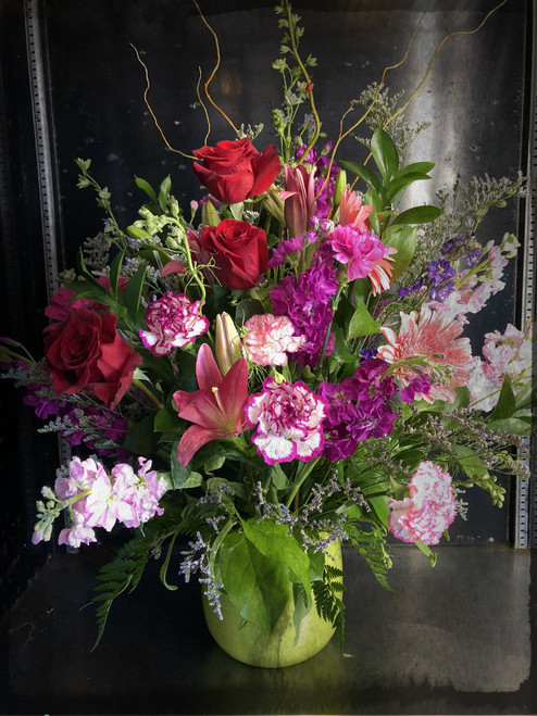 "Simply stunning - large floral display for any occasion.  Roses, lilies, sweet smelling stock, carnations and other seasonal flowers arranged and accented with limonium curly willow and other greens.  You won't be forgotten when you send this arrangement.  Size approximately 30"" tall by 28"" wide  rounded ."