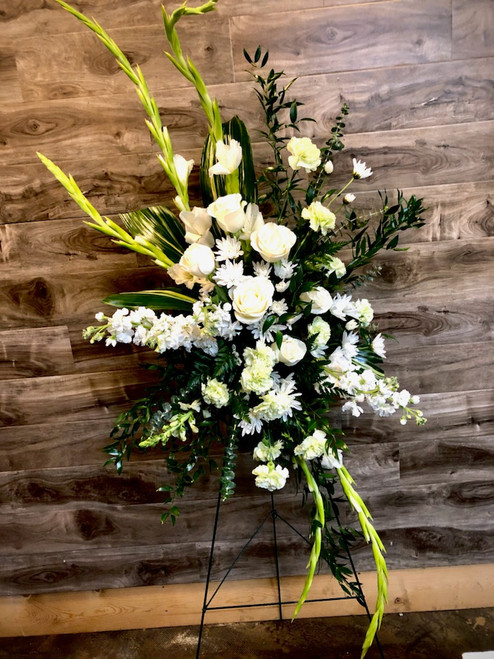 A cultured, cooling and calming way to express your love and sympathies.  This standing easels contains combinations of all greens and whites in eucalyptus, roses, glads, mums, stock and carntions.