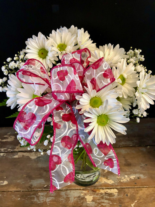 This vase full of daisies and babies breath is garnished with a huge valentine bow.  Perfect for your school age kiddos or anyone who loves daisies .  The bonus - it's inexpensive!