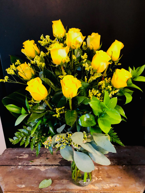 Why stick to red, when you can send 12 of these vibrant  yellow long stem roses, intermingled with flowery limonium and imbedded in classical greens like ruscus, eucalyptus and ti leaves.