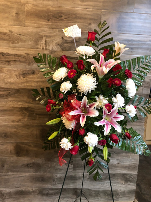 Stargazer lilies, red roses, white football mums join together to present a royal tribute to your beloved.