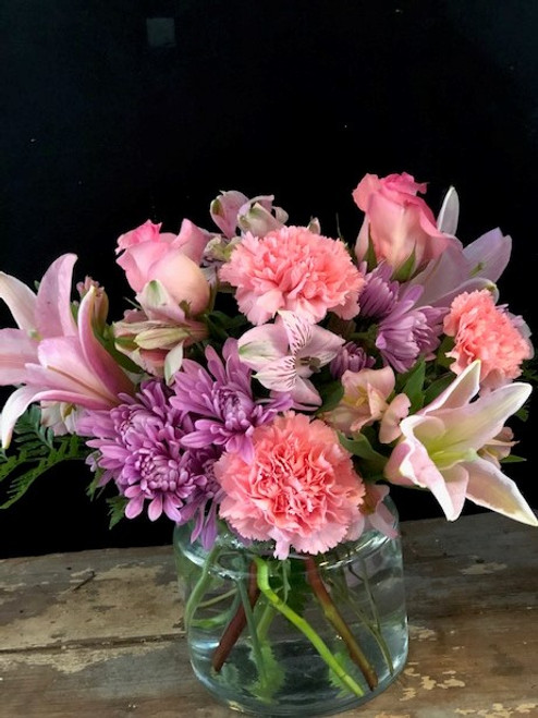 Sweet and special as the woman in your life, this arrangement of roses, lilies, carnations and alstromeria in lavenders and pinks will make her feel like she is truly loved.
