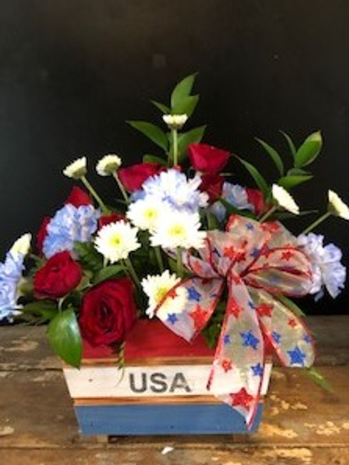 Celebrate your freedom with a cedar planter handmade here in the Ozarks - chock full of red roses, blue carnations and white mums.  A perfect centerpiece for the festivities.