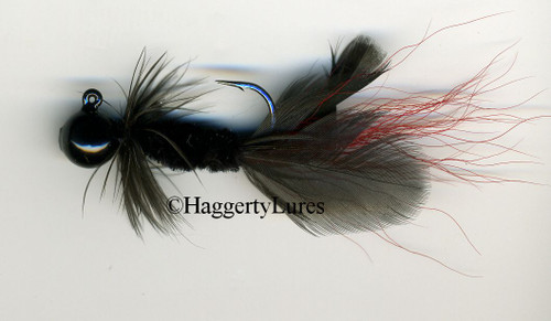 Black Hellraiser Sculpin jig with red tail.
