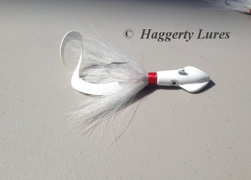 White Squid bucktail jig with curly attractor tail.