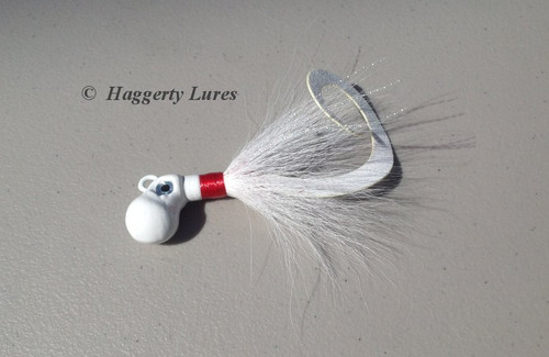 octopus bucktail jig - White, with a curly Attractor tail.