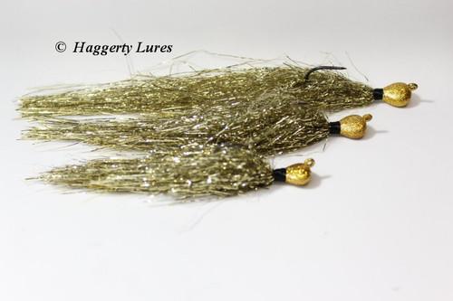 Three sizes of Gold Muskie Flash Jigs.