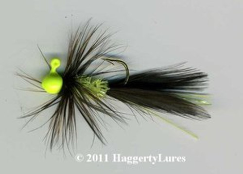 Black and Glow Yellow Bugz jig. Glow in the Dark Yellow Chenille and flash.