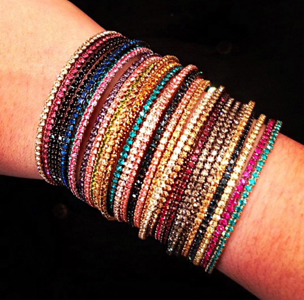 Assorted Rainbow Stack of 18 1 Line Crystal Wrap Bracelets Shown on Arm