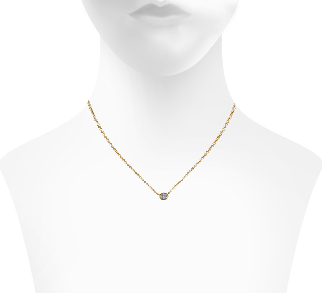 Yellow Gold Plated Encased Crystal Necklace Shown on Neck