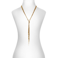 Yellow Gold Plated Sequin Knot Necklace Shown on Neck