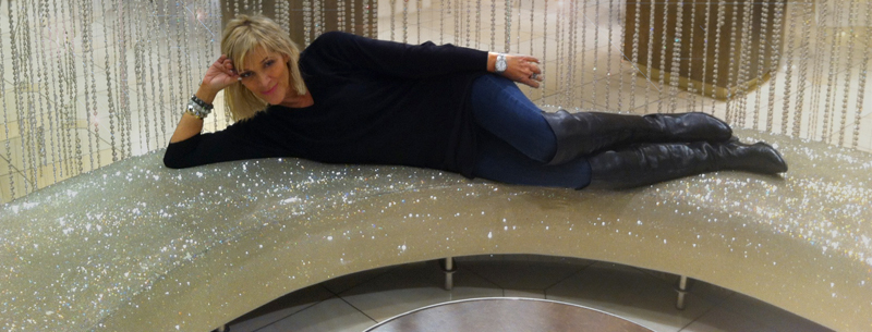 Lisa Freede laying on a sparkly couch