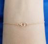 14K Yellow gold three princess diamond bracelet