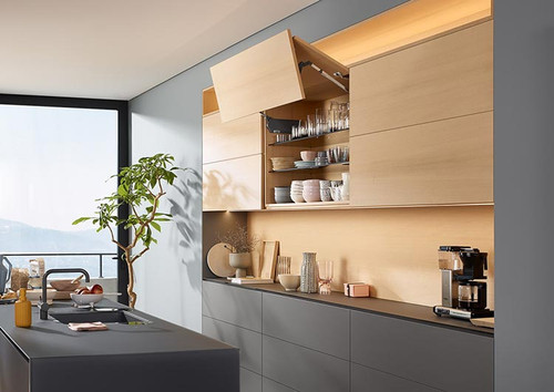 AVENTOS HF bi-fold lift system allows easy access to wall unit contents