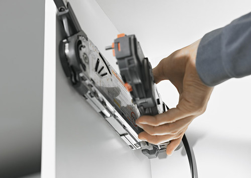The drive unit is clipped on tool-free to the left AVENTOS HF lift mechanism