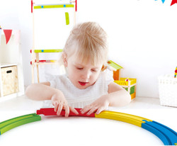 Hape Rainbow Track Pack Kid Playing