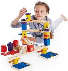girl playing with Quadrilla Music Motion Set - Wooden Marble Run