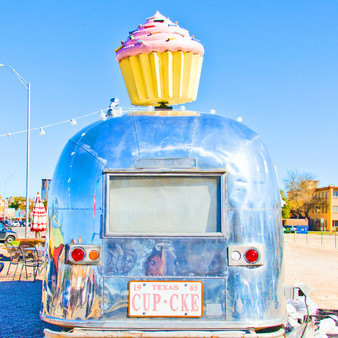 Cupcakes are the draw at this whimsical shop operating out of a parked trailer with outdoor seating.