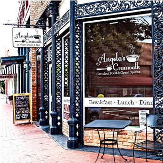 Angela's at the Crosswalk is a laid-back eatery with live music known for serving upscale comfort food and cocktails. The restaurant opened in 2011. The restaurant is designed like a European Cafà , much like a bistro in France or Italy.