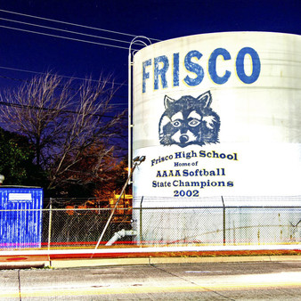 Showing off its AAAA Softball Champions in 2002, Frisco High School puts the face of its mascot on a giant water tank.