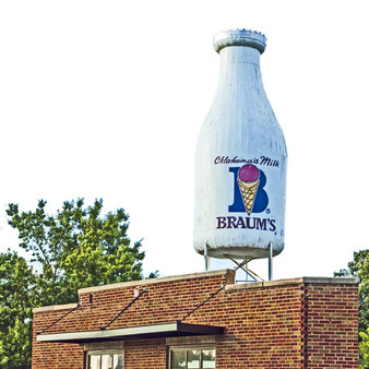 The Milk Bottle Grocery, located at 2426 N. Classen Boulevard in Oklahoma City, Oklahoma, is a grocery building with a large metal Braum's milk bottle atop its roof. The store was constructed in 1930, and the milk bottle was added in 1948.