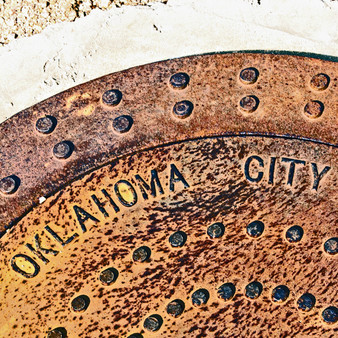 Providing a point of reference, this Oklahoma City mahole quickly became a fun staple piece as it features a map of the entire town including a white dot letting you know where you are on it. This has become one of the biggest city photo-ops as well as an actual resource.