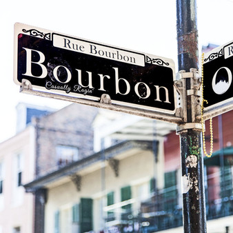 Bourbon Street sign at the corner of Orleans, in the French Quarter.