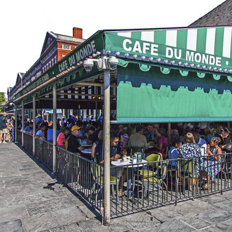 Iconic New Orleans cafe known for cafà au laits, chicory coffee & beignets since 1862.