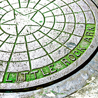 This photo is an artistic take on a common, everyday item: a city manhole cover in Little Rock, AR.