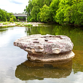 The Round Rock, a large stone in Brushy Creek, marks the site where wagons made low-water crossings in the 19th century. Nearby, Chisholm Trail Crossing Park has plaques detailing the city's cattle-driving history.