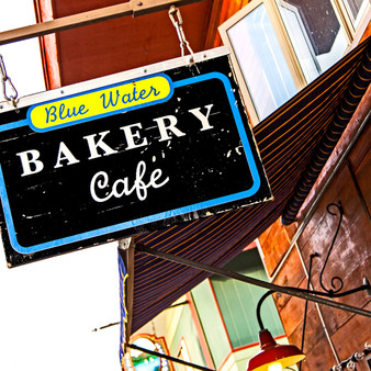 The Blue Water Bakery Cafà is located in the heart of beautiful Grand Lake, Colorado.  The cafà is known for its delicious pastries, coffee, and breakfast and lunch offerings.
