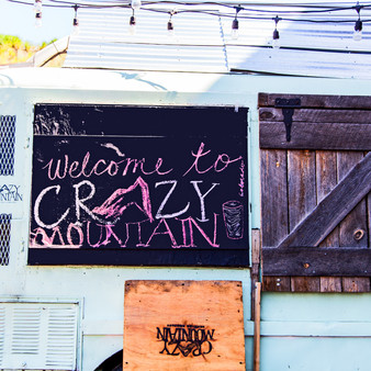 Home to the Crazy Mountain Brewery Taproom and Beer Garden, this funky sign welcomes all to its industrial setting that serves house made beer.
