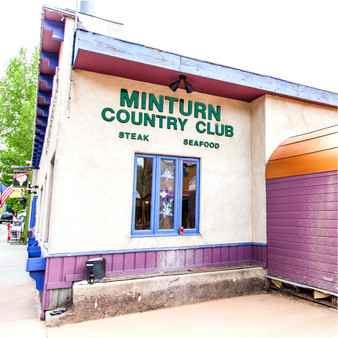 """Minturn Country Club is a """"grill it yourself"""" steak house that is fun for the entire family, located only minutes from Vail Ski Resort. At this family-owned steakhouse, you'll discover long-standing tradition, quirky wall art and a manager who has some serious skills with magic tricks."""