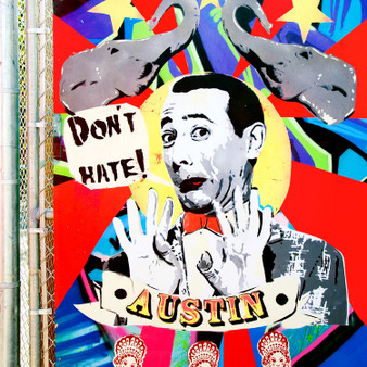 This mural was put up behind Home Slice on Congress Ave to block the view of the dumpster area. This piece showcases the comical character Pee-wee Herman.