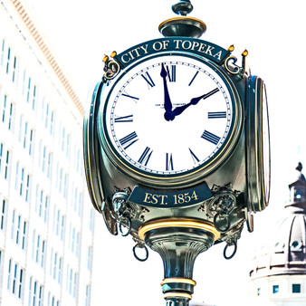 <p>This lamp post clock stands tall in Topeka, KS!<p><p>Click &lsquo;Choose a Product&rsquo; above to get this image hand printed on a ceramic 4x4 custom coaster, cutting board, magnet, ceramic trivet, ornament, dog tag or canvas.</p>