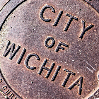<p>This artistic photo puts a creative spin on a common object - a manhole cover in Wichita, KS.<p><p>Click &lsquo;Choose a Product&rsquo; above to get this image hand printed on a ceramic 4x4 custom coaster, cutting board, magnet, ceramic trivet, ornament, dog tag or canvas.</p>