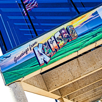 <p>This wall mural is one of 41 created by Muralist Victor Ving and photographer Lisa Beggs. Using the classic large letter postcard style, they have revitalized communities with imagery from the city and bright colors across 20 states!<p><p>Click &lsquo;Choose a Product&rsquo; above to get this image hand printed on a ceramic 4x4 custom coaster, cutting board, magnet, ceramic trivet, ornament, dog tag or canvas.</p>