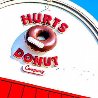 <p>Hurts Donut is the rebel of all donuts! These donuts break all the rules with their uniform-free toppings and amped up flavors!<p><p>Click &lsquo;Choose a Product&rsquo; above to get this image hand printed on a ceramic 4x4 custom coaster, cutting board, magnet, ceramic trivet, ornament, dog tag or canvas.</p>