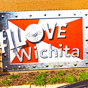<p>The #ILoveWichita hashtag was adopted by the Wichita Regional Chamber of Commerce and the Young Professionals of Wichita in February 2015 for social media postings about the things that make Wichita unique. This was one of several murals created. <p><p>Click &lsquo;Choose a Product&rsquo; above to get this image hand printed on a ceramic 4x4 custom coaster, cutting board, magnet, ceramic trivet, ornament, dog tag or canvas.</p>