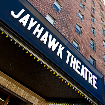 <p>The Historic Jayhawk State Theatre of Kansas, is a theater located in downtown Topeka, Kansas, United States. The theatre opened on August 16th 1926. The Jayhawk Hotel & Crosby Bros shopping complex where attached to the theatre making it a grand complex for visitors to eat, sleep and be entertained. <p><p>Click &lsquo;Choose a Product&rsquo; above to get this image hand printed on a ceramic 4x4 custom coaster, cutting board, magnet, ceramic trivet, ornament, dog tag or canvas.</p>