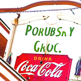 <p>Porubsky Grocery is a Russian deli by the old Santa Fe main line that has been serving up simple sandwiches since 1947. <p><p>Click &lsquo;Choose a Product&rsquo; above to get this image hand printed on a ceramic 4x4 custom coaster, cutting board, magnet, ceramic trivet, ornament, dog tag or canvas.</p>