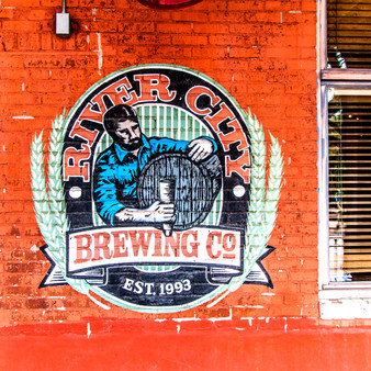<p>River City Brewing Co. was founded in 1993 and can be found in the heart of Old Town in Wichita, KS,<p><p>Click &lsquo;Choose a Product&rsquo; above to get this image hand printed on a ceramic 4x4 custom coaster, cutting board, magnet, ceramic trivet, ornament, dog tag or canvas.</p>