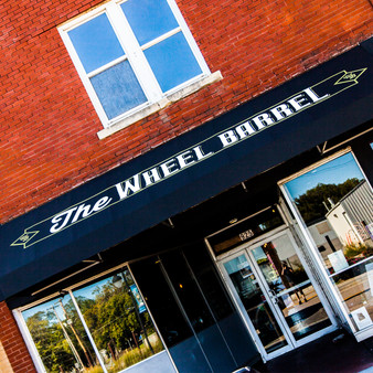 <p>The Wheel Barrel is a comfy, rustic spot in Topeka, KS offering gourmet grilled cheese sandwiches, craft brews & a seasonal patio.<p><p>Click &lsquo;Choose a Product&rsquo; above to get this image hand printed on a ceramic 4x4 custom coaster, cutting board, magnet, ceramic trivet, ornament, dog tag or canvas.</p>
