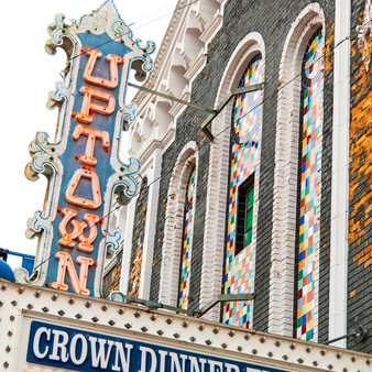 """The Uptown Theatre was designed by the Boller Brothers and built by George Siedhoff. It opened on July 16, 1928 with Al Jolson in """"The Jazz Singer"""". It operated as a first run movie venue. It went through a remodel and conversion to Cinerama in 1961. The 1920's style vertical marquee has been restored to its original beauty."""