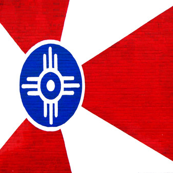 <p>Art takes many forms around Wichita, but none give the city as urban of a feel as the many murals throughout the metro area including the state flag! <p><p>Click &lsquo;Choose a Product&rsquo; above to get this image hand printed on a ceramic 4x4 custom coaster, cutting board, magnet, ceramic trivet, ornament, dog tag or canvas.</p>