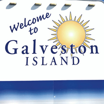 "Welcoming back visitors and locals, this up-beat ""Welcome to Galveston Island"" sign uses its bright colors and illustration of the sun, to represent how you'll leave feeling due to its positive charm."