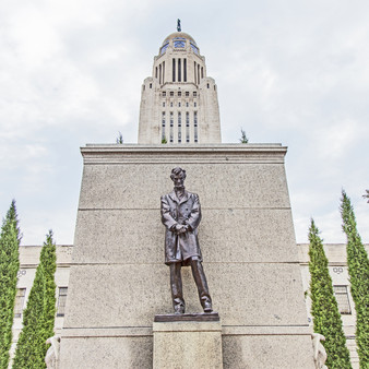 This bronze statue of Abraham Lincoln is located on the grounds of the Nebraska State Capitol. The monument was commissioned by the Abraham Lincoln Memorial Association of Lincoln, Nebraska, and produced between 1909 and its unveiling in 1912. The statue was cast in bronze by Jno. Williams, Inc. of New York. Its architectural setting was created by French's longtime collaborator Henry Bacon.