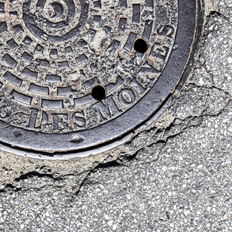 This manhole cover was phototed in Des Moines, IA.
