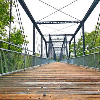 With views across the Guadalupe River, this bridge features some historical markers about New Braunfels, itself.